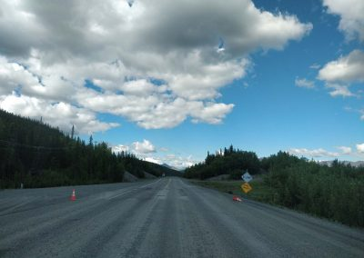 Photo showing some regular road damage found along the Tok Cutoff Highway